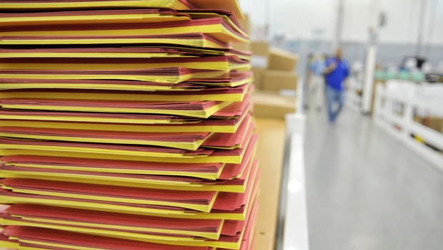 alternating stacks of red and yellow paper