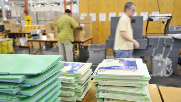 stacks of green and blue paper