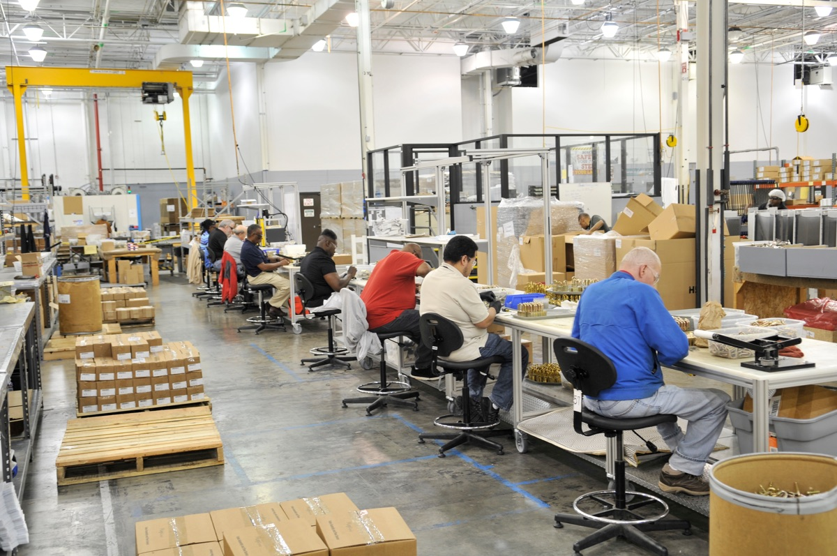 LCI employees assembling locks on the manufacturing floor