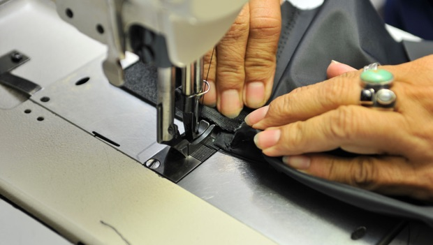 LCI employee's hands and a sewing machine