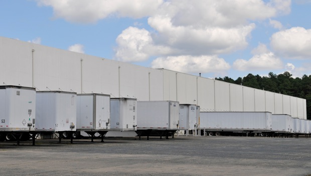 white LCI distribution trucks