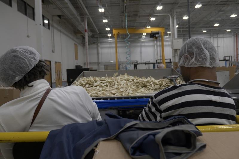 LCI employees, assembling plastic cutlery