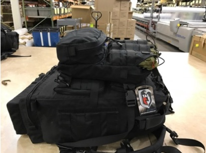 black backpack, filled with medical kitting supplies